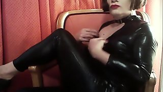 Selina Teases in Shiny Black Catsuit
