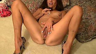 Charming brunette MILF masturbating with fine pearls