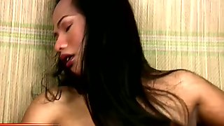 Filipino dream t-girl is petting her curvy body and shecock