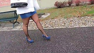 Fashionable blue denim skirts and blue high heels