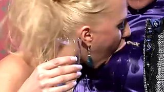 Seductive lesbian chics kiss in lips after wetting their bodies with champagne